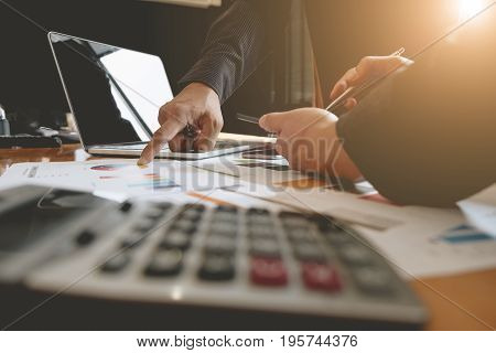 Business Corporate People Discussing The Charts And Graphs Showing The Results Of Their Successful T