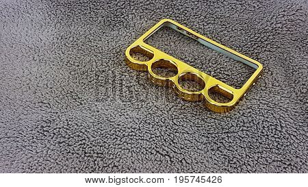 Knuckle Ring Mobile Case In Varnish Golden Color