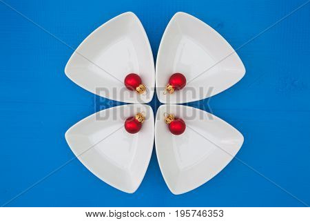 Christmas decoration and triangular ceramic bowls for sushi on the blue wooden table