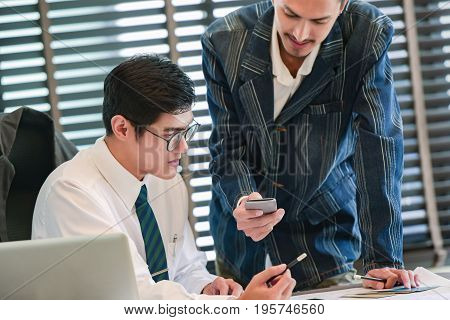 Businessman,Graphic design partners working together using smart phone,meeting