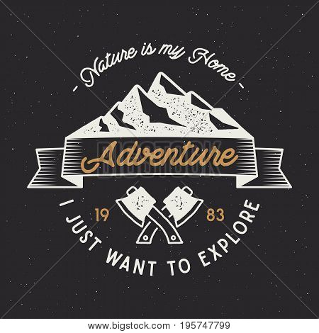 Vintage adventure label. Mountain expedition emblem with crossed axes and typography design nature is my home . Wanderlust old style. Outdoors activity insignia for t shirt print. isolated.