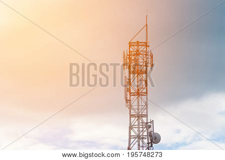 Antenna Of Cellular And Communication System Tower With The Blue Sky And Cloud.