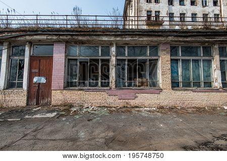 Broken windows of an abandoned building. The broken building.