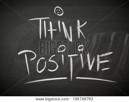 Black chalkboard with the words Think Positive business or lifestyle concept background