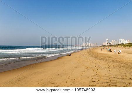 Beach And Ocean Against Distant Blue Durban City Skyline