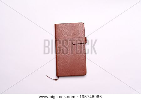 brown leather diary on the white background