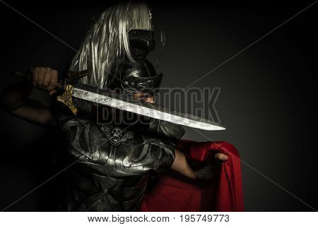 Caesar, Roman centurion with armor and helmet with white chalk, steel sword and long red cape
