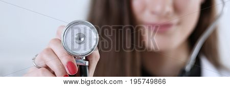 Female Medicine Doctor Hand Holding Stethoscope Head Closeup