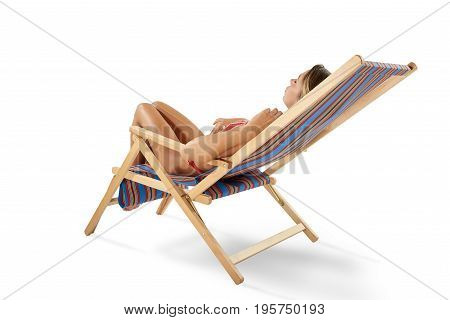 Girl tans on a deck chair isolated on white background