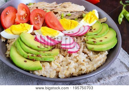 Useful breakfast: oatmeal with rabbit meat avocado boiled egg tomatoes radish green peas flax seeds. Proper nutrition.