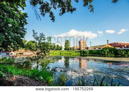 Beautiful view across the river to the tower of an old paper factory in Belarus, Dobrush town