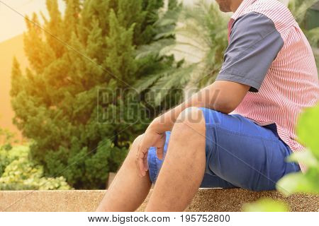 Man sitting and waiting someone.Or man relax in holiday