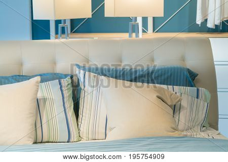 unmade messy bed room pillow and blue sheet relax morning concept