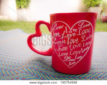 Love in heart red cup of coffee