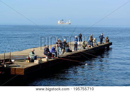 Vladivostok Russia - October 01 2016: Fishermen catch fish in the sea. Coast of the Sea of Japan.
