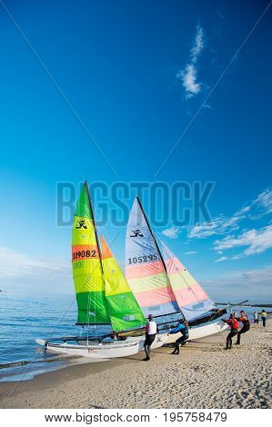 Windsurfer Or Man Sportsman Surfs And Sails On Board