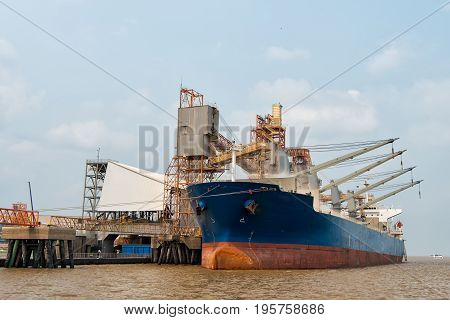 Logistics and transportation of International Container Cargo ship in the ocean at dock Freight Transportation Shipping