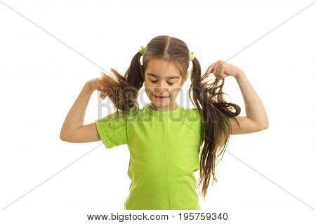 funny little girl with pigtails in green shirt isolated on white background