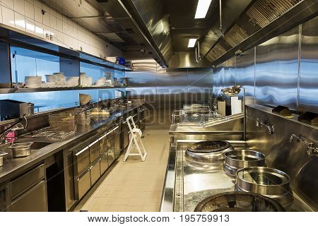 Professional kitchen view counter in stainless steel .