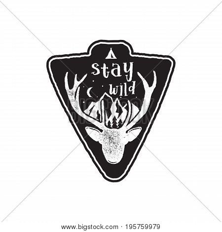 Hand drawn vintage camping badge and hiking label with wild animals design elements. Included deer head, mountains and quote text- stay wild . Old style patch. Rustic stamp .