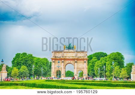 Paris France-June 1 2016 : Triumphal Arch (Arc de Triomphe du Carrousel) at Tuileries gardens in Paris France. Monument was built between 1806-1808 to commemorate Napoleon's military victories.