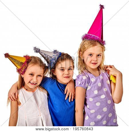Birthday children celebrate party and eating cake on plate together. Portrait of three kids happy girl in party hat on isolated. Sisters of holiday girl at celebration.