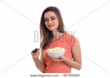 lovely young woman with tv remote and pop-corn watching movies isolated on white background