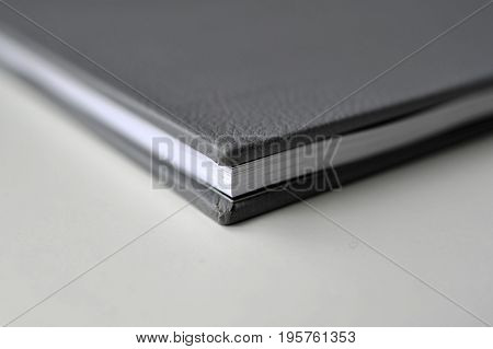A black leather cover book print in photo book