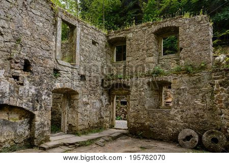 Interior medieval mill Dolsky Mlyn in the Bohemian Switzerland National Park, medieval ruins in eastern Europe
