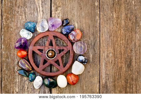 Wooden Wiccan Pentagram With Incense Burning Surrounded By Crystals - On Wooden Background