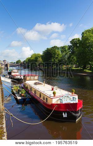 York UK River Ouse looking towards Skeldergate Bridge with boat