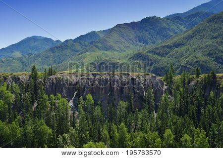 Steep green hills and forest in Altai mountains. Altay Republic Siberia Russia.