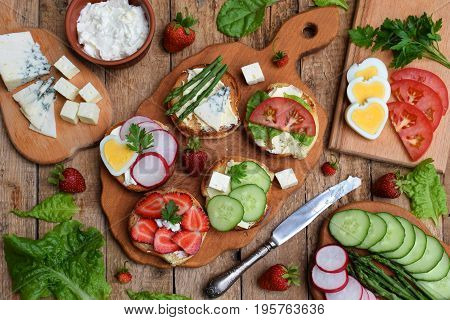 Set Of Healthy Whole Wheat Bread Sandwiches With Fuits, Vegetables, Cheese And Leafy Green Herbs On