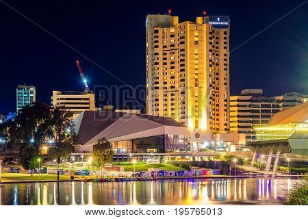 Adelaide Australia - April 16 2017: InterContinental Hotel in Adelaide CBD illuminated at night viewed across Torrens river