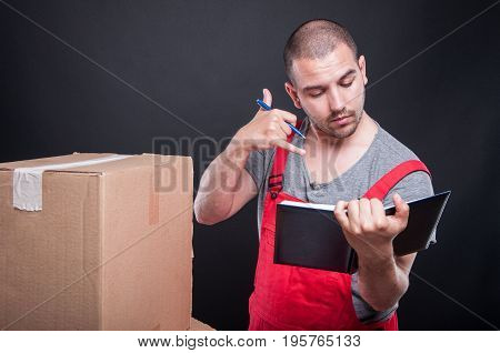 Mover Guy Writing In Agenda Making Calling Gesture
