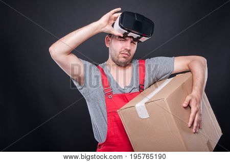 Mover Guy Holding Box And Vr Glasses Over His Eyes
