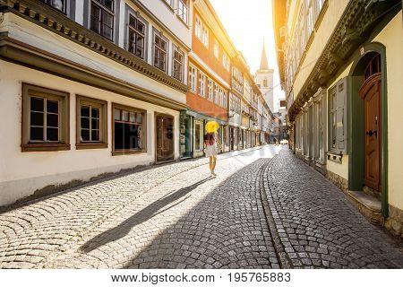 Young woman tourist walking on the famous Merchants bridge in Erfurt city, Germany