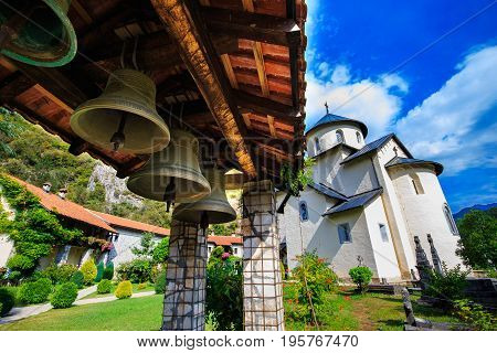 Moraca Monastery, a Serbian Orthodox monastery, church bells and courtyard in Kolasin, Montenegro.