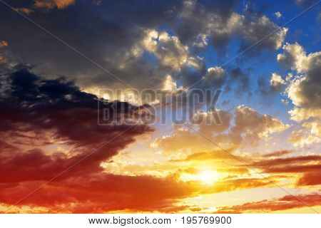 Dramatic colorful sky with clouds at sunset. Nature background.