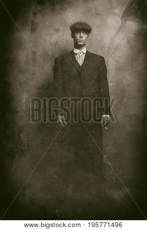 Antique Wet Plate Photo Of 1920S English Gangster Standing With Cigarette. Wearing Suit And Flat Cap