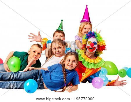 Birthday child clown playing with children and bunny fingers prank. Kid with holiday balloons on birthday. Fun of group people pose for camera on white background. Children holiday in kindergarten.