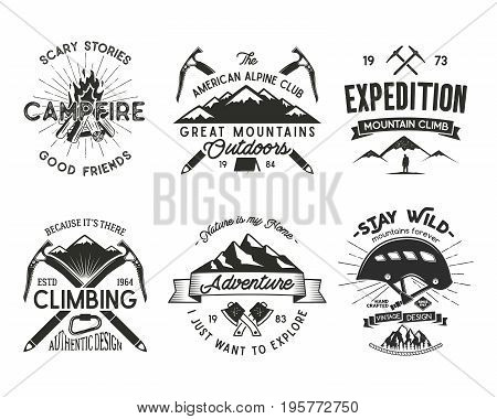Vintage mountaineering badges set. Climbing logo, vintage emblems. Climb alpinism gear - helmet, carabiner, campfire. Retro t shirt design. Old style illustration. Letterpress effect.