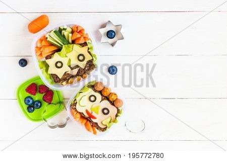School lunch box for kids on white wooden background. Back to school. Top view flat lay
