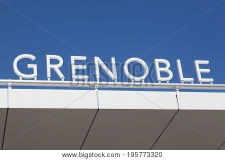 Grenoble sign on a building in France