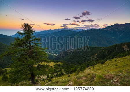 Colorful Sunlight On The Majestic Mountain Peaks, Woodland And Valleys Of The Italian French Alps.