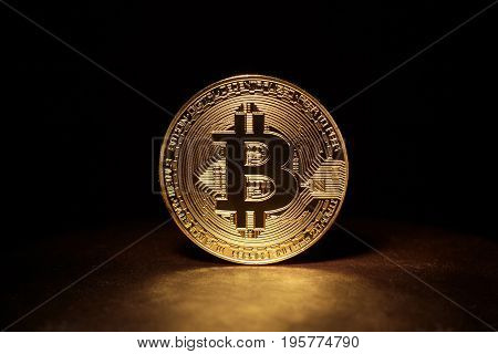 Golden Bitcoin Coin on black background. Bitcoin cryptocurrency. Business concept.