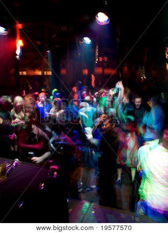 Nightclub dance crowd in motion