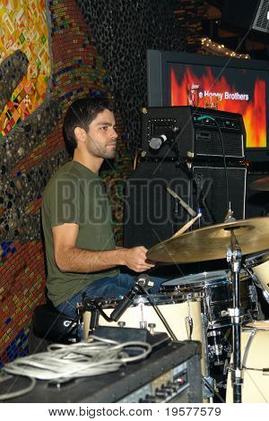 Adrian Grenier of the Honey Brothers live on the drums in nightclub