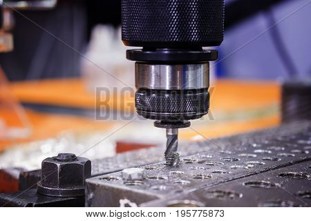 Tapping tool in spindle tapping into a hole in steel plate;Tapping machine; selective focus