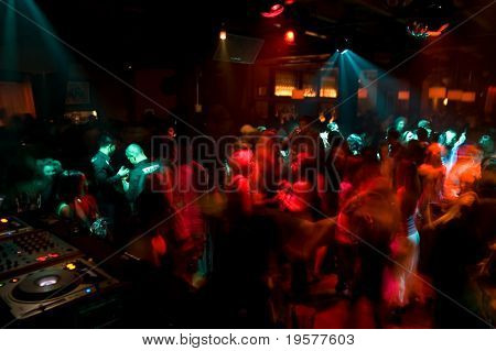 Nightclub dance crowd in motion
